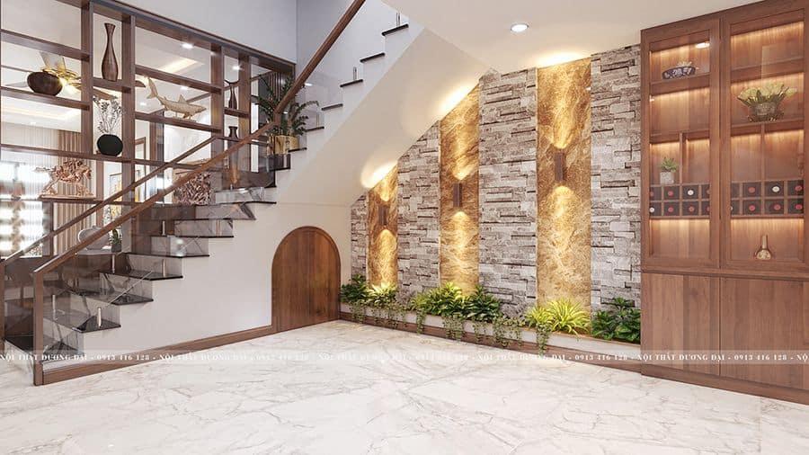 Phía dưới cầu thang được tận dụng làm nhà kho và trang trí tiểu cảnh cho gia đình.