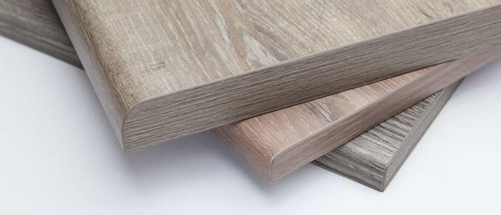 Laminate vân gỗ bọc ngoài ván gỗ dăm hoặc MDF