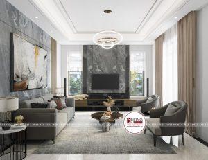 Phòng khách tầng 1 được thiết kế sang trọng với gam màu ghi trầm